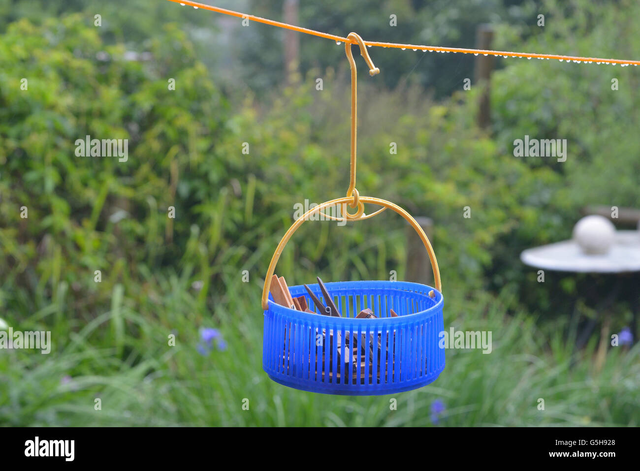 Washing line and clothes peg bag in the rain. England. UK - Stock Image