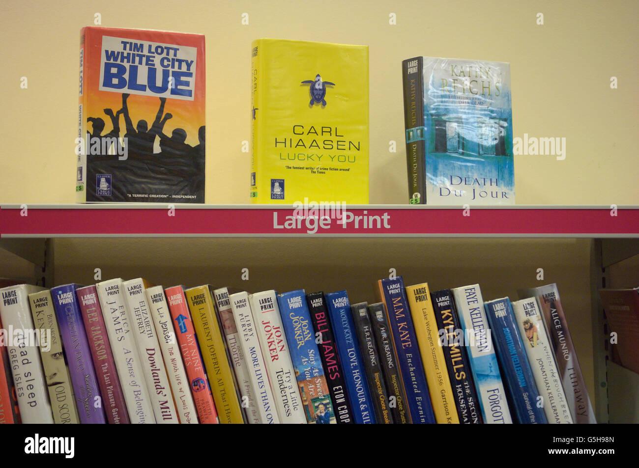 Public library large print book self. England. UK - Stock Image