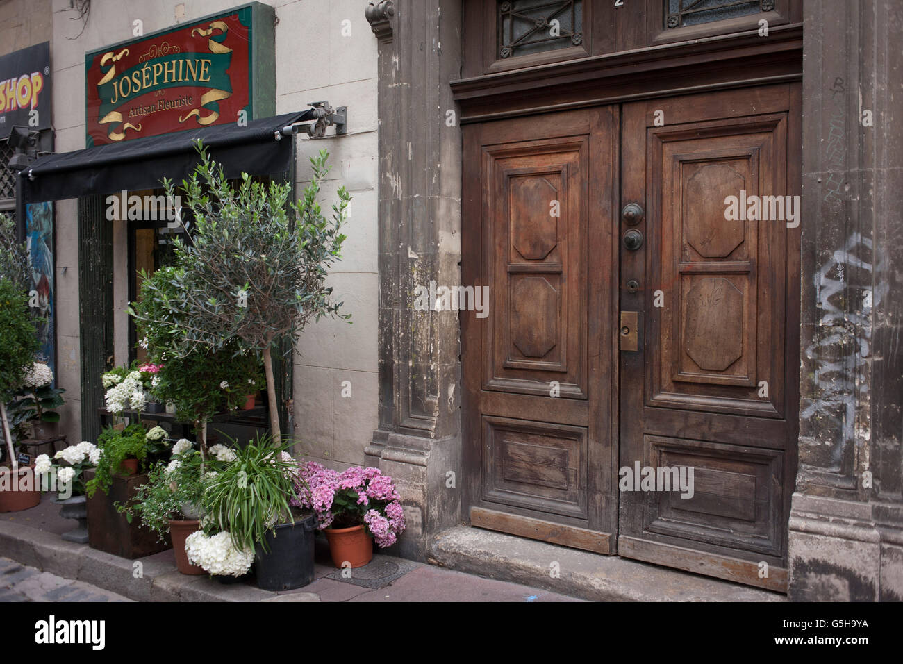 Florist Business And Old Doorway In A Side Street Of Montpellier, South Of  France.