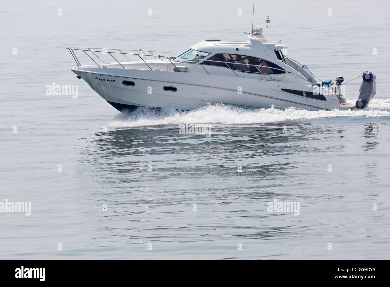 Play it by Ear Sealine c39 powerboat cruising in the sea at Bournemouth in June - Stock Image