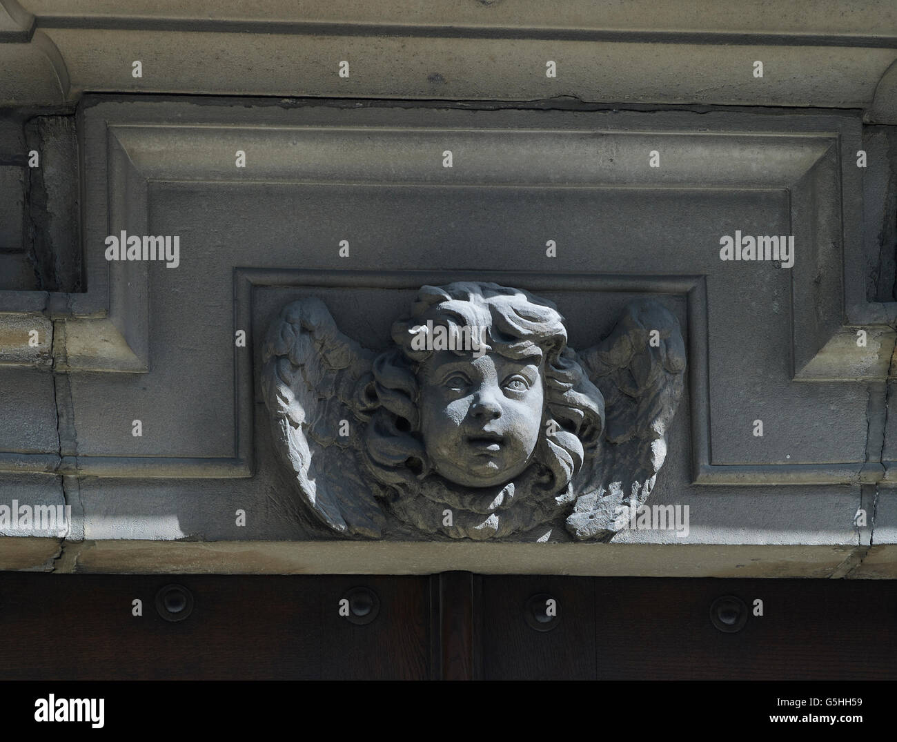 St Lawrence Jewry, church in the City of London, by Christopher Wren 1670s. Stone carving of Cherub over door. - Stock Image