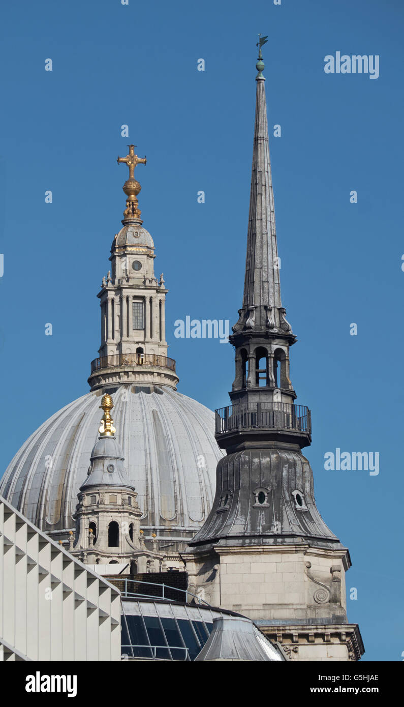 St Martin within Ludgate, church in the City of London, spire with St Paul's dome - Stock Image