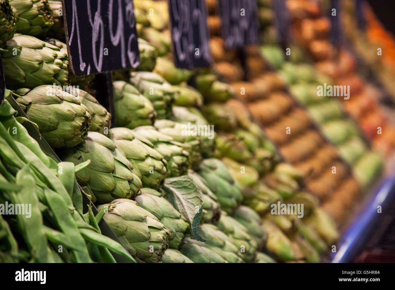 Fruits and vegetables stall in La Boqueria, the most famous market in Barcelona. Stock Photo