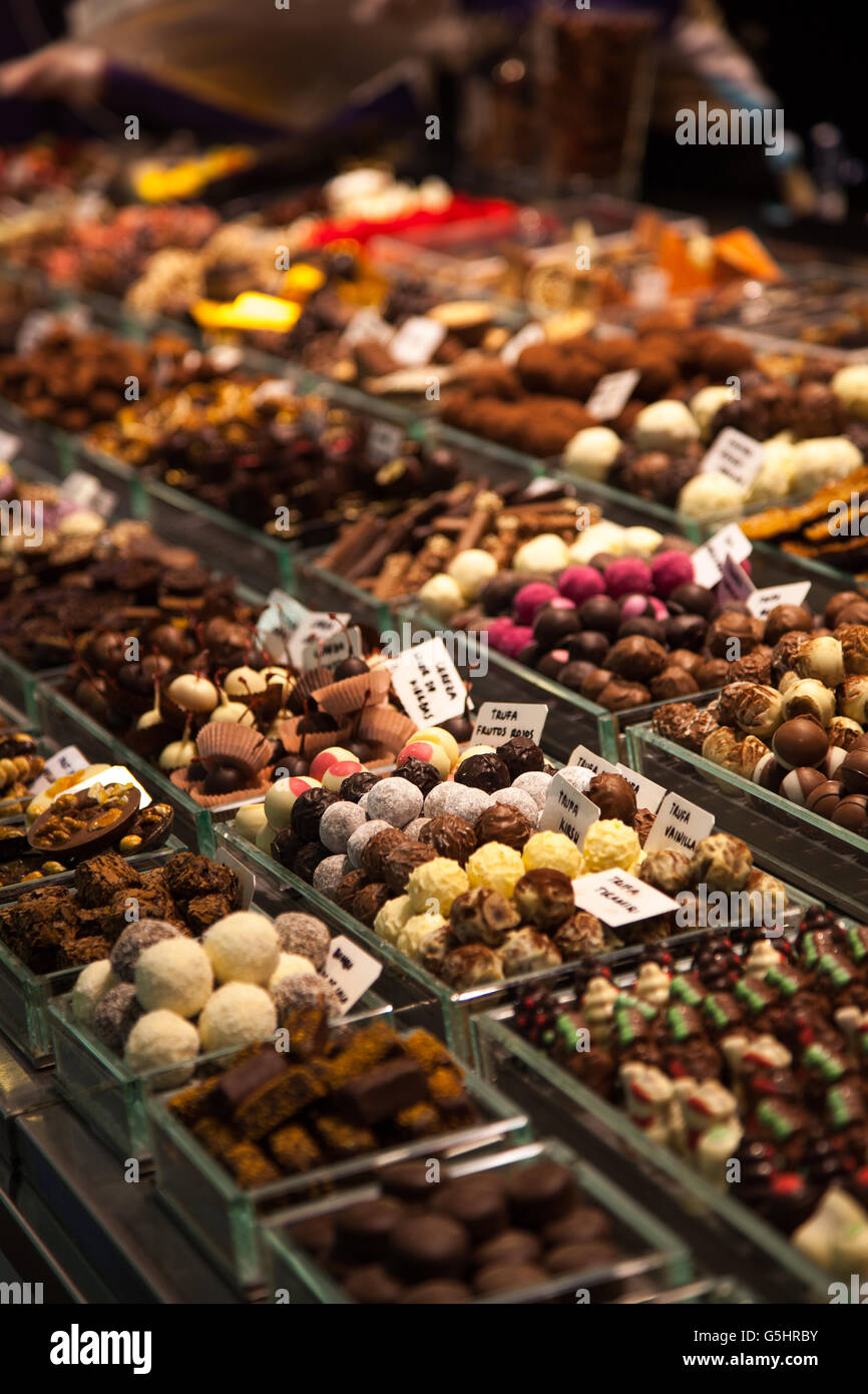 Various Nuts, almonds, sweets and dried fruits for sale at the market Stock Photo