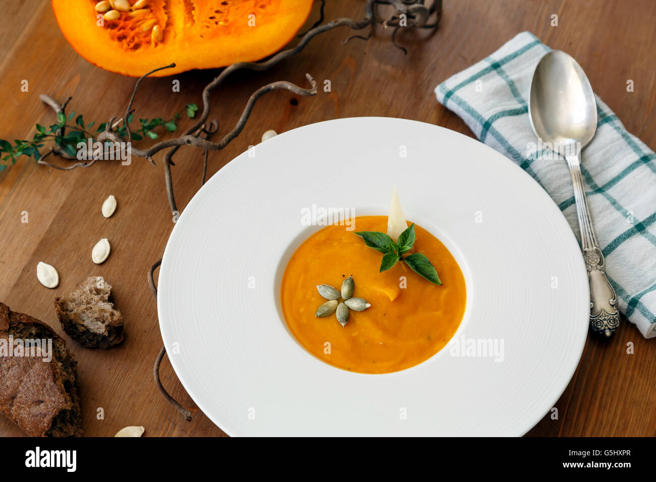 Pumpkin soup in white modern plate, dietary vegetable soup. - Stock Image