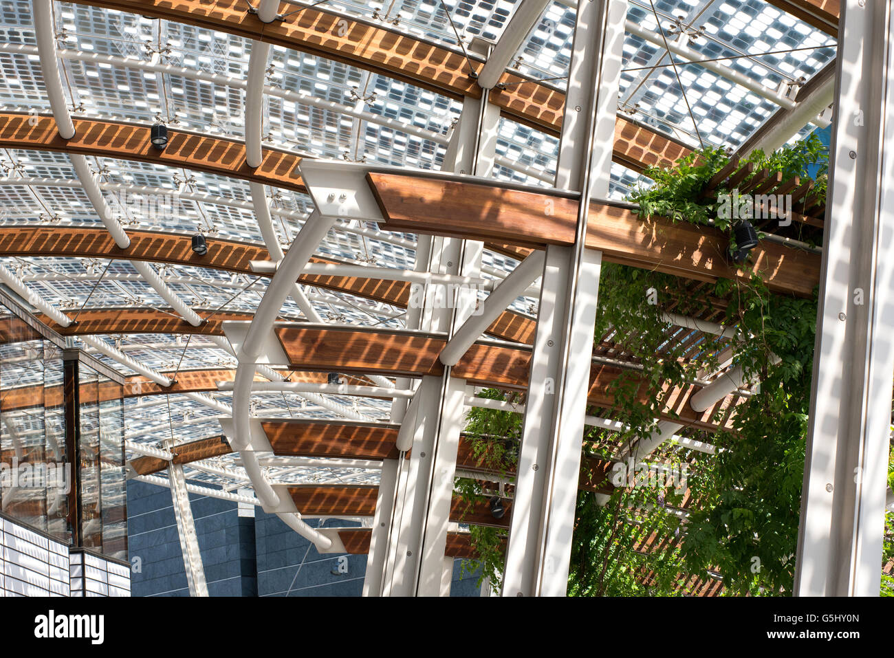 Architectural background of a modern roof structure on beams with a pattern of geometric squares - Stock Image