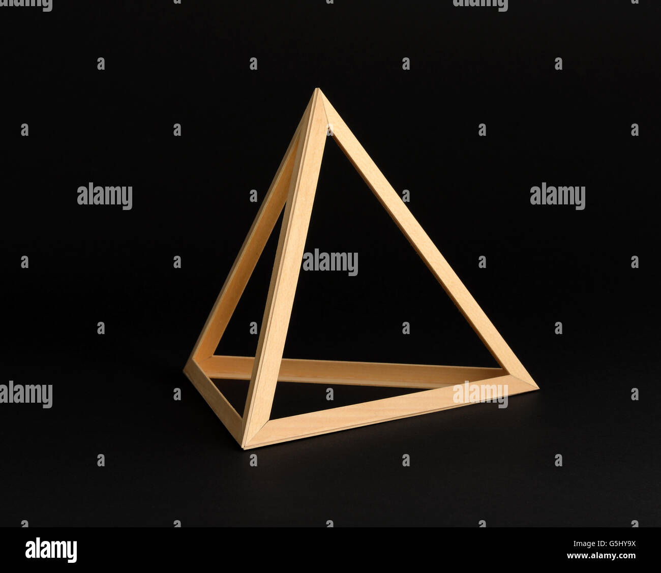 Three dimensional wooden triangle in the form of an open sided frame - Stock Image