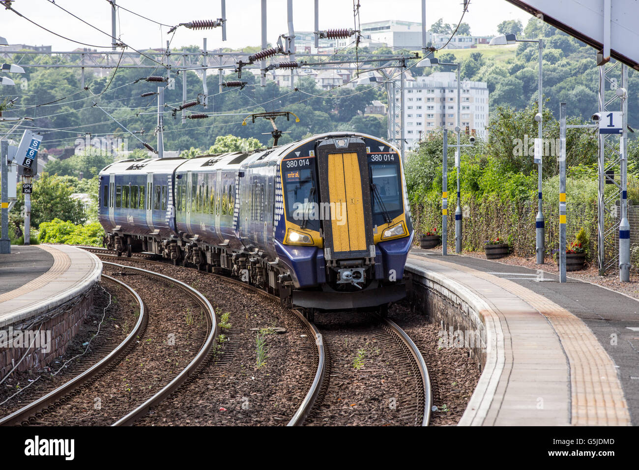 A  Class 380 electric train pulls into Fort Matilda train station. - Stock Image