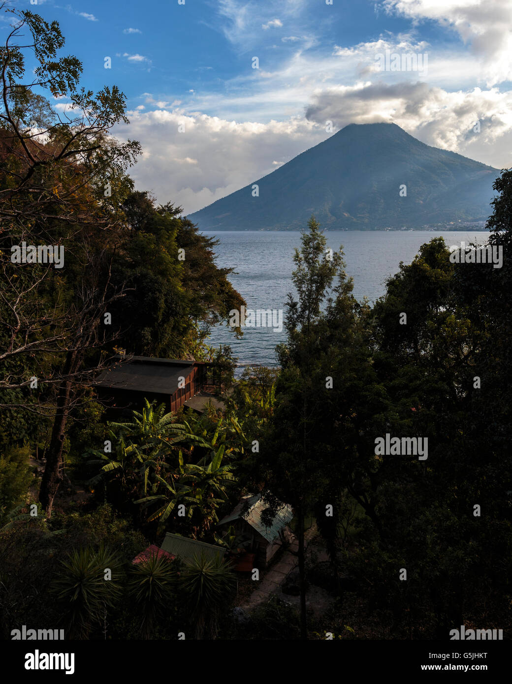A house tucked away in the forests surrounding Lake Atitlan in Guatemala on the edge of the town of San Marcos. - Stock Image