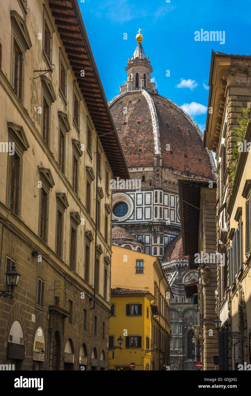 Street of Florence with Santa Maria del Fiore Cathedral, also called Duomo, in the back, Tuscany, Italy - Stock Image