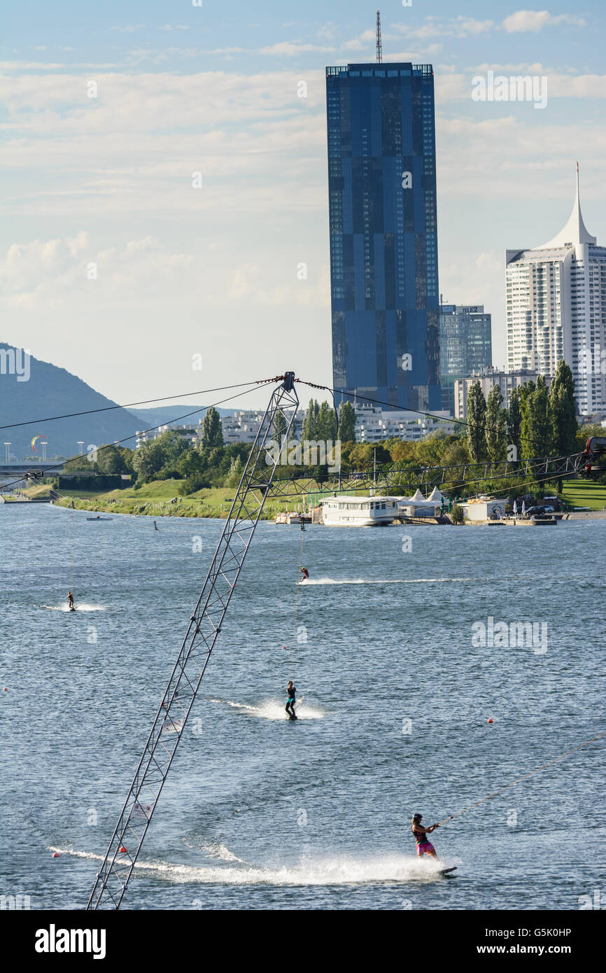 Wakeboarding with a water ski lift in the New Danube before the DC Tower 1 and the Hochhaus Neue Donau, Wien, Vienna, - Stock Image