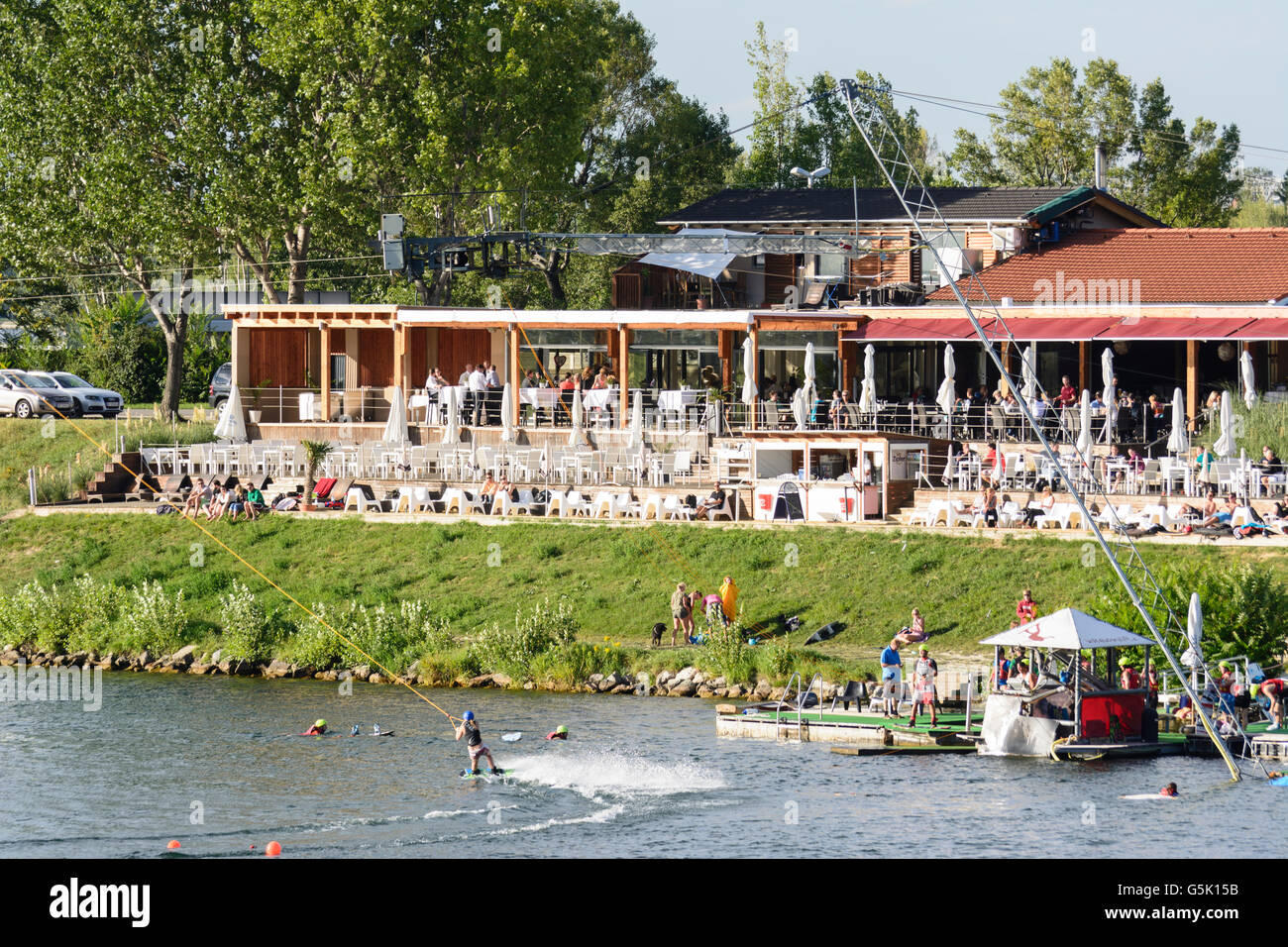 Wakeboarding with a water ski lift in the New Danube, restaurant, Wien, Vienna, Austria, Wien, 22. - Stock Image