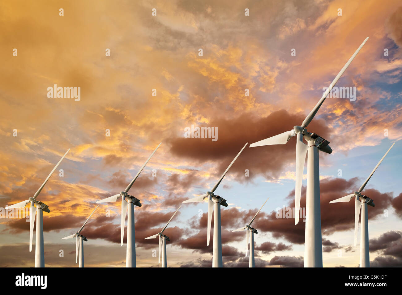 Wind Energy Blows Into Future Amarillo And Turbine Farms On Blue Sunset In Twilight Background - Stock Image