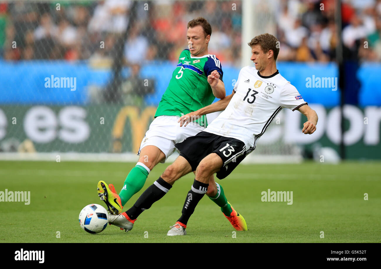 4468f715cb Northern Ireland s Jonny Evans (left) and Germany s Thomas Muller (right)  battle for the ball during the UEFA Euro 2016