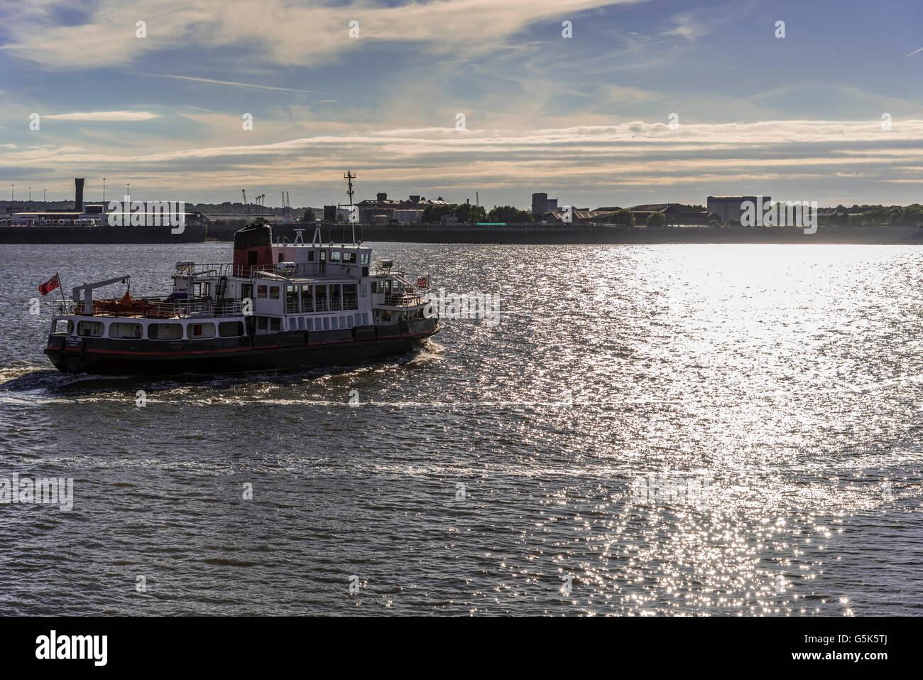 Liverpool Merseyside North West England. The Mersey ferry the Royal Iris crossing the river Mersey in the evening - Stock Image