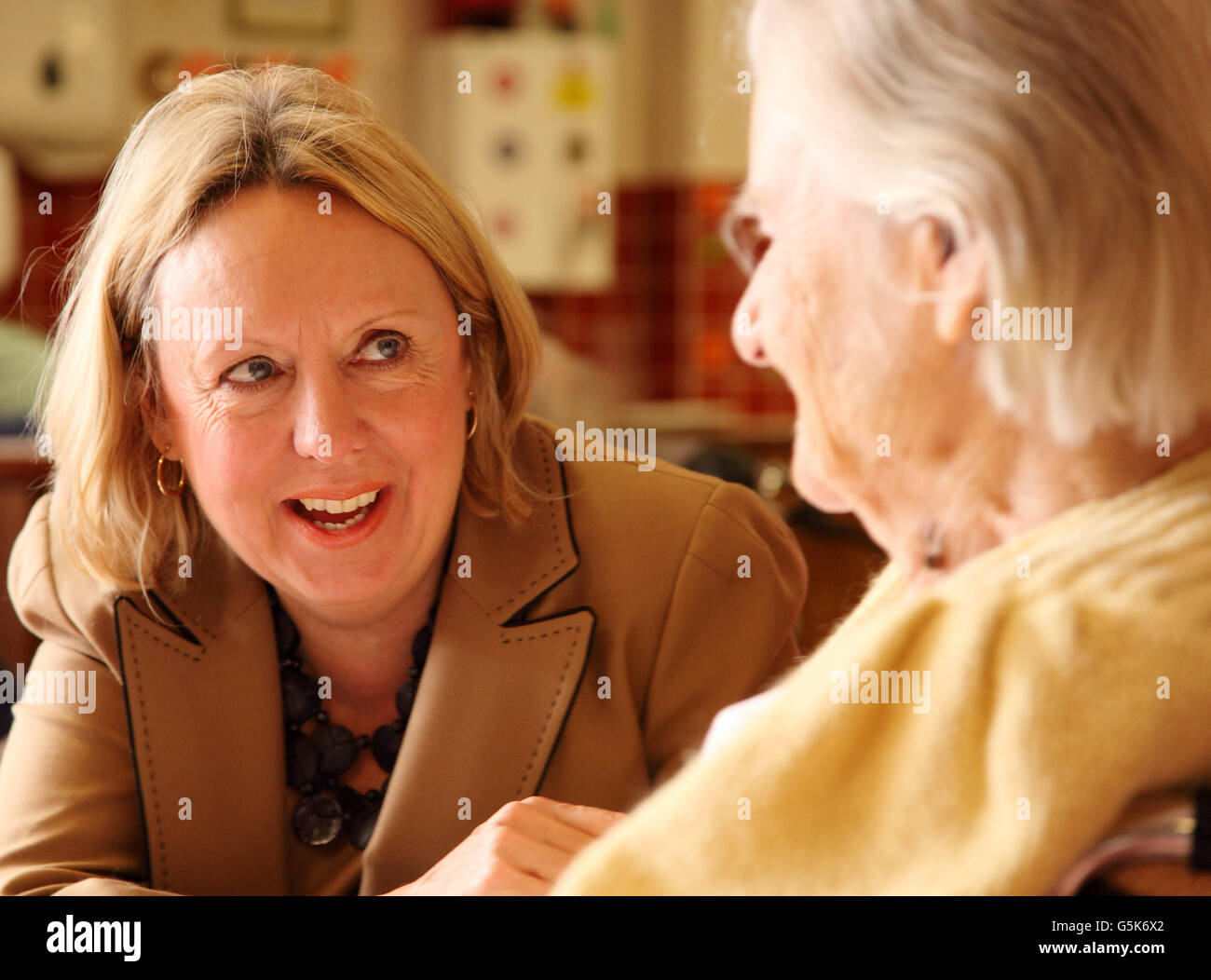 Lorely Jane Burt, Baroness Burt of Solihull, ex Liberal Democrat Member of Parliament for Solihull, chats to a pensioner - Stock Image