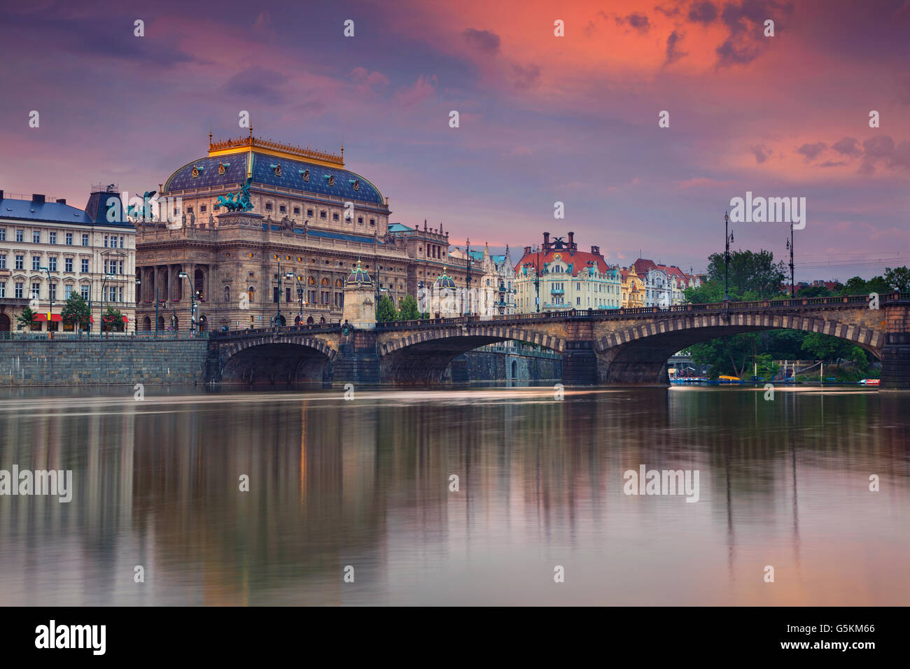 Prague. Image of Prague riverside with reflection of the city in Vltava River. - Stock Image