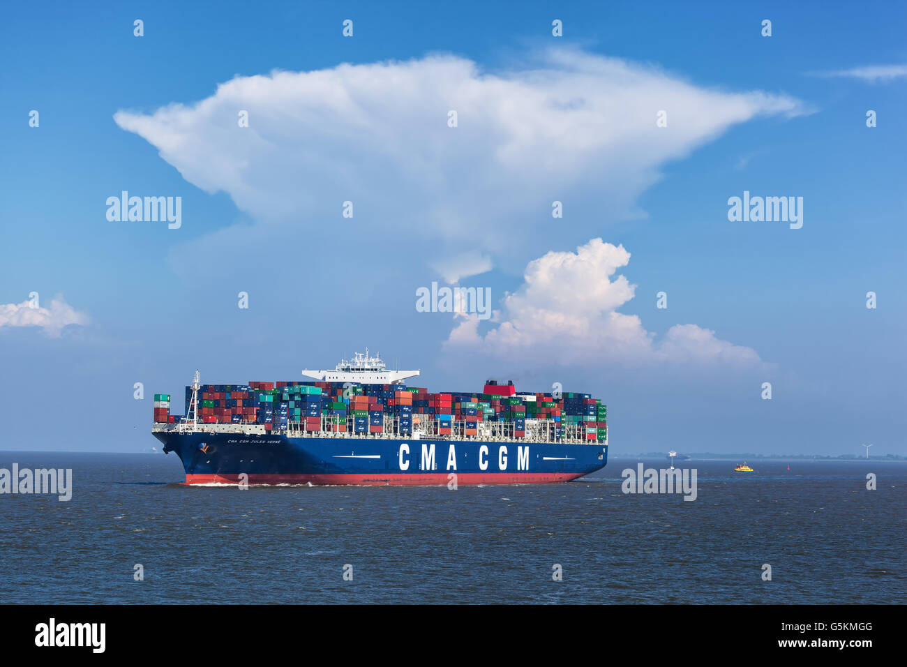 CMA CGM Jules Verne passing Cuxhaven after leaving Hamburg. - Stock Image