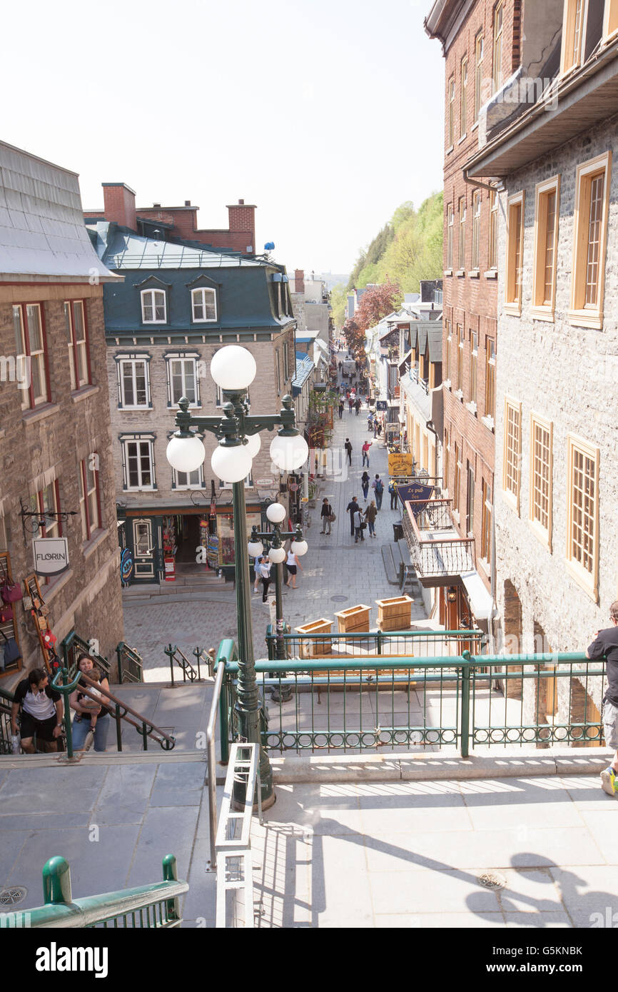 QUEBEC CITY - MAY 24, 2016: Located at the foot of Cap Diamant, in Lower Town, the Petit-Champlain district can - Stock Image