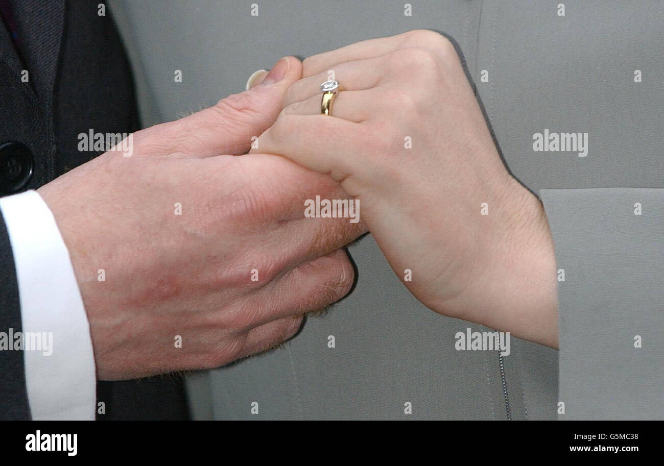 Engaged Couple Holding Hands Stock Photos & Engaged Couple Holding ...