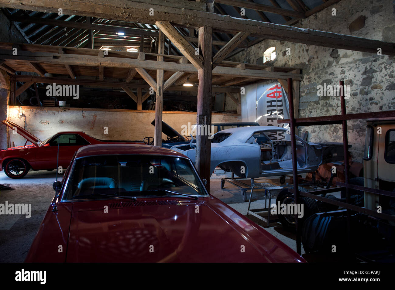 Classic cars and modern-era classic cars can be seen in a storage ...
