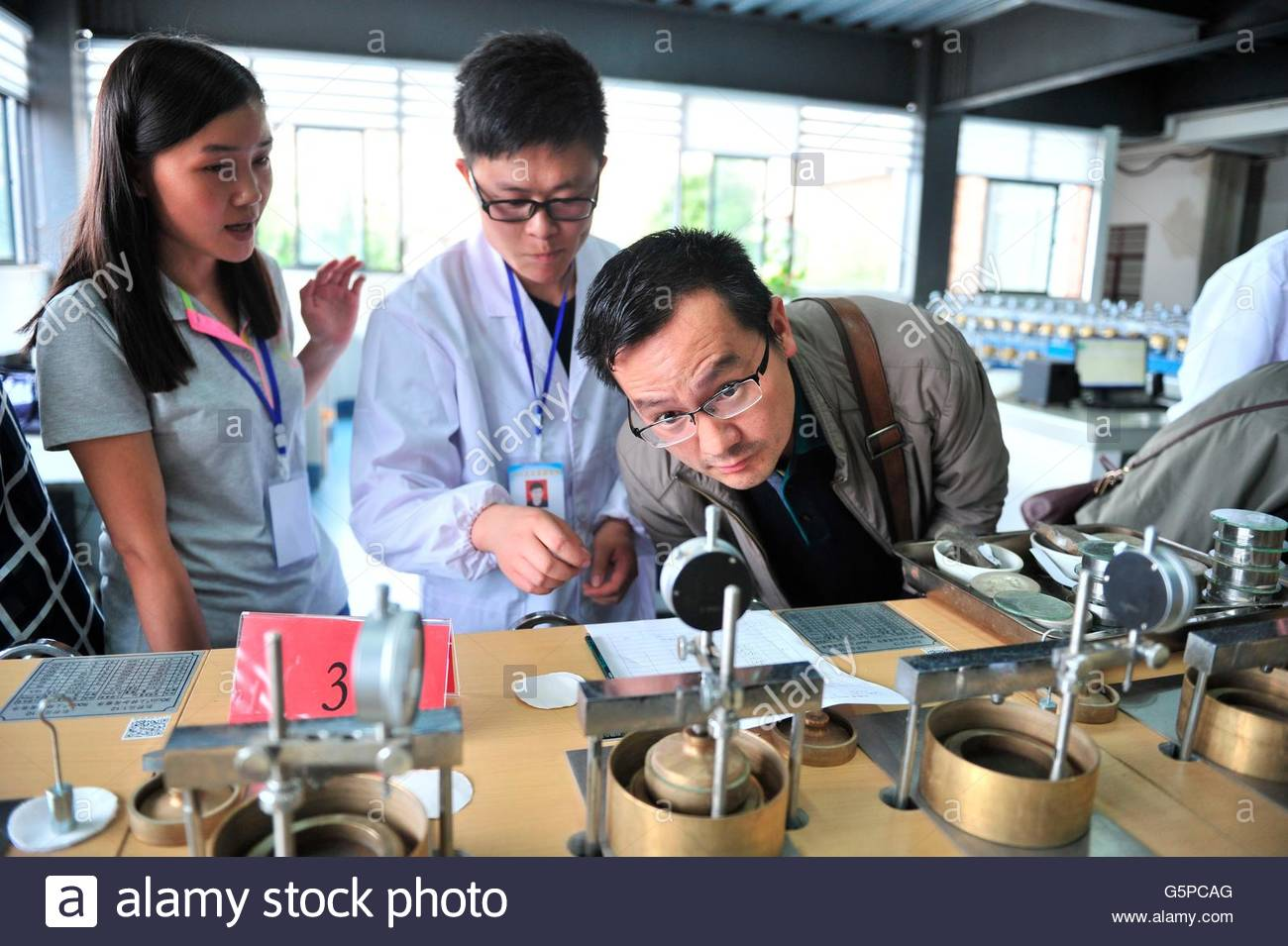 Kunming, China. 22nd June, 2016. The 30 geotechnical experimenters compete to prove professional skills through - Stock Image