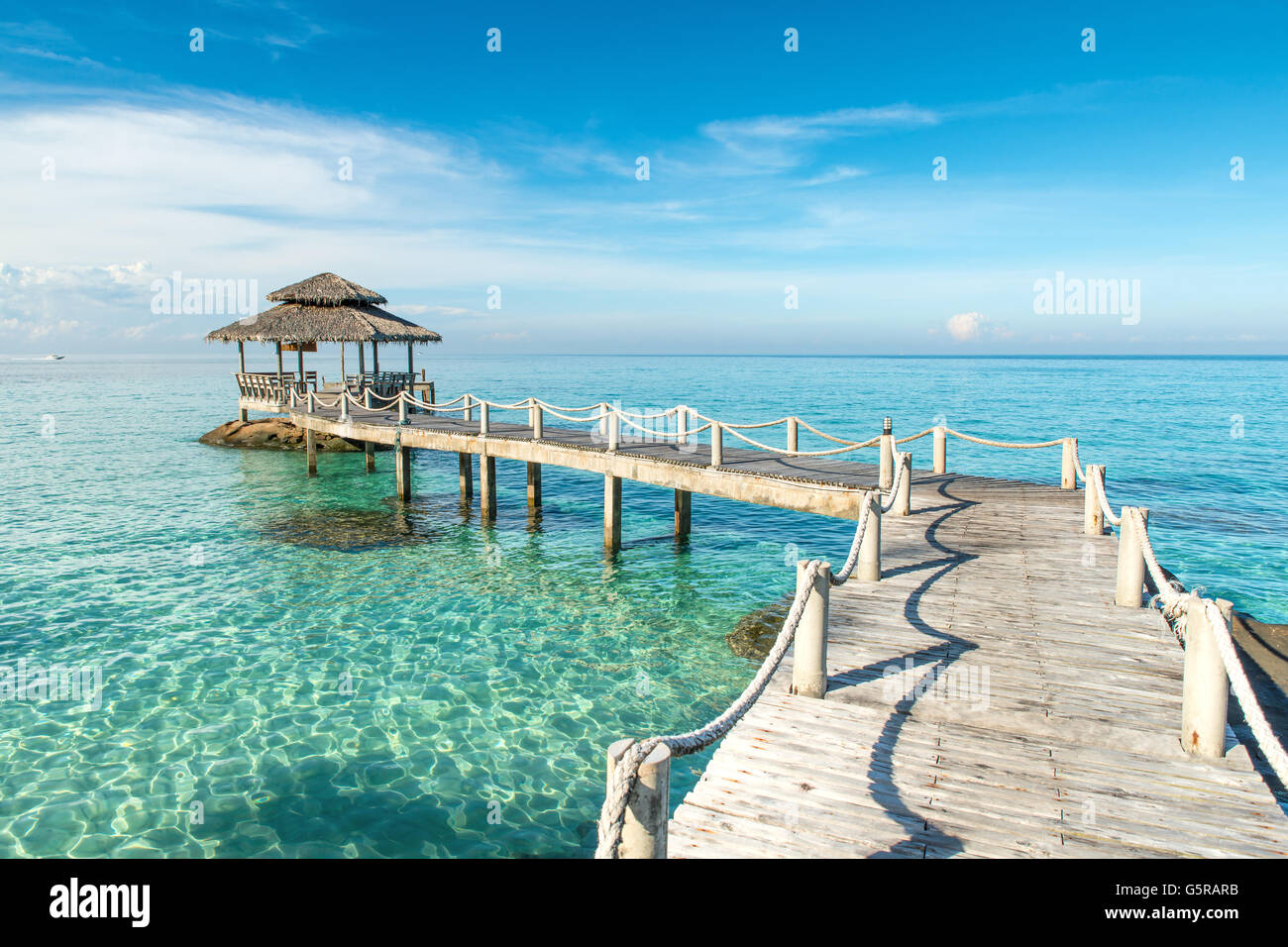 Summer, Travel, Vacation and Holiday concept - Wooden pier in Phuket, Thailand. Use for Summer Travel and Summer - Stock Image