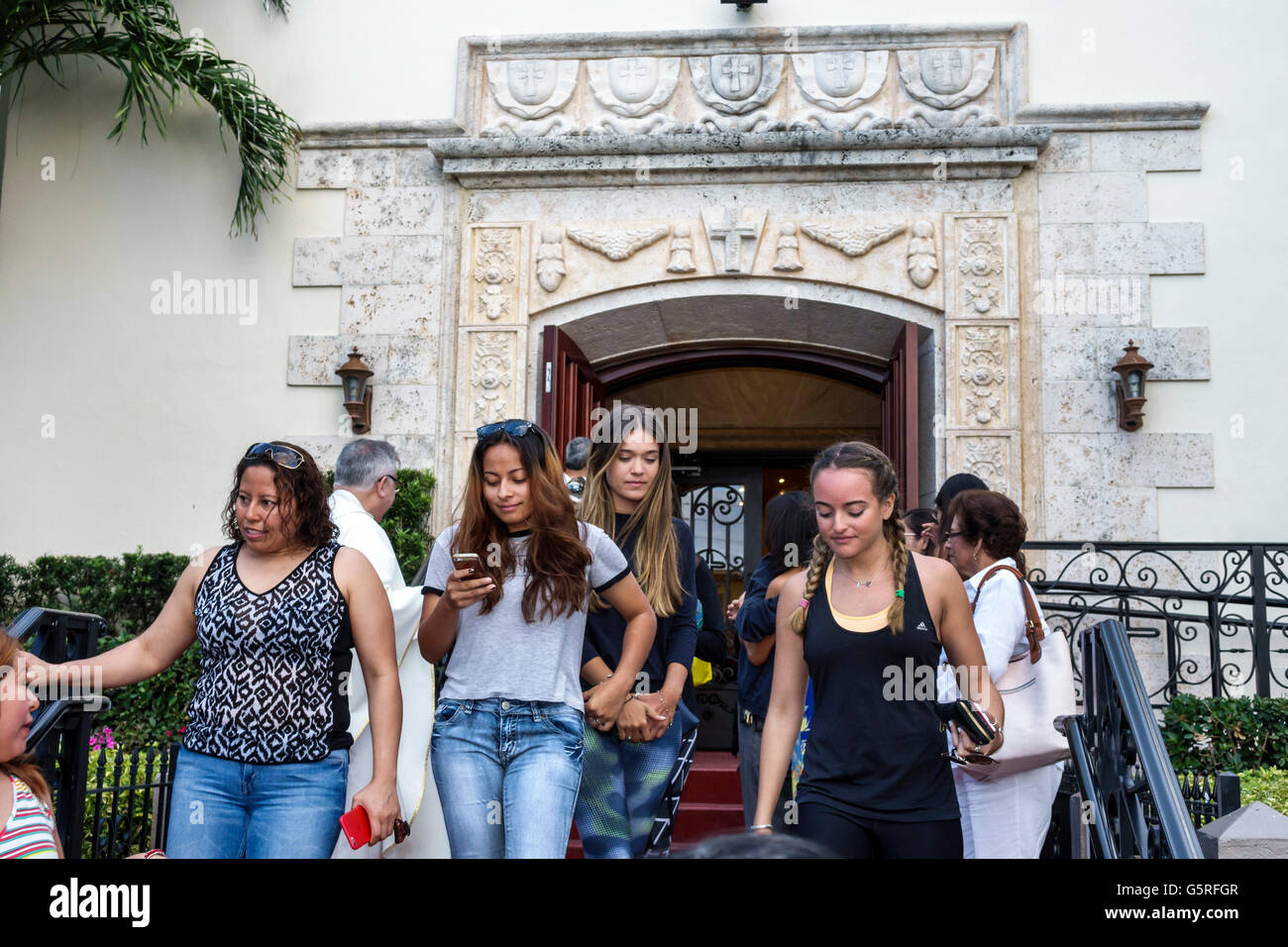 Miami Florida Beach St. Francis De Sales Catholic Church members after service leaving Hispanic teen girl - Stock Image