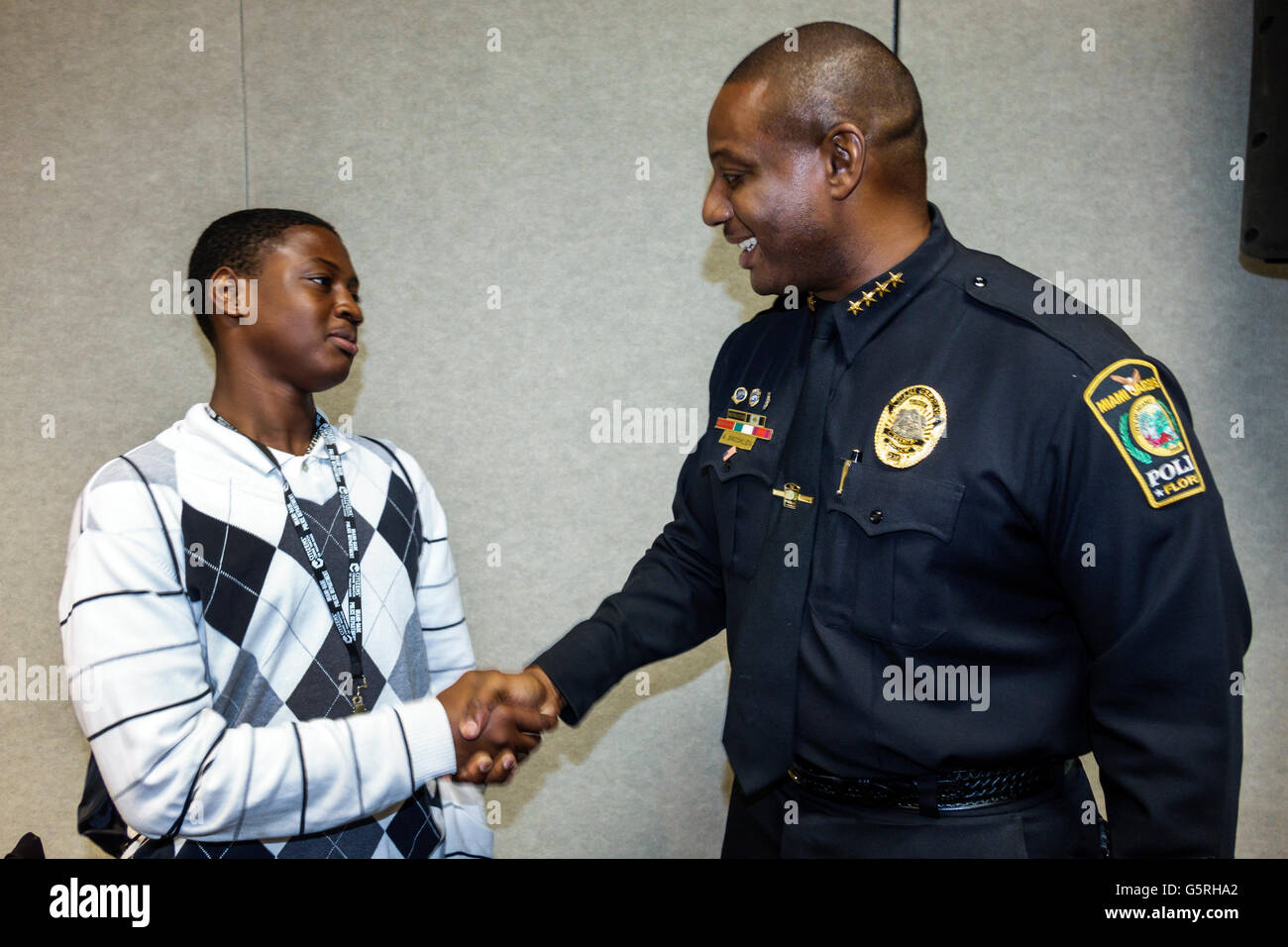 Miami Florida Hyatt hotel National Preventing Crime in the Black Community Conference Black student teen boy police - Stock Image