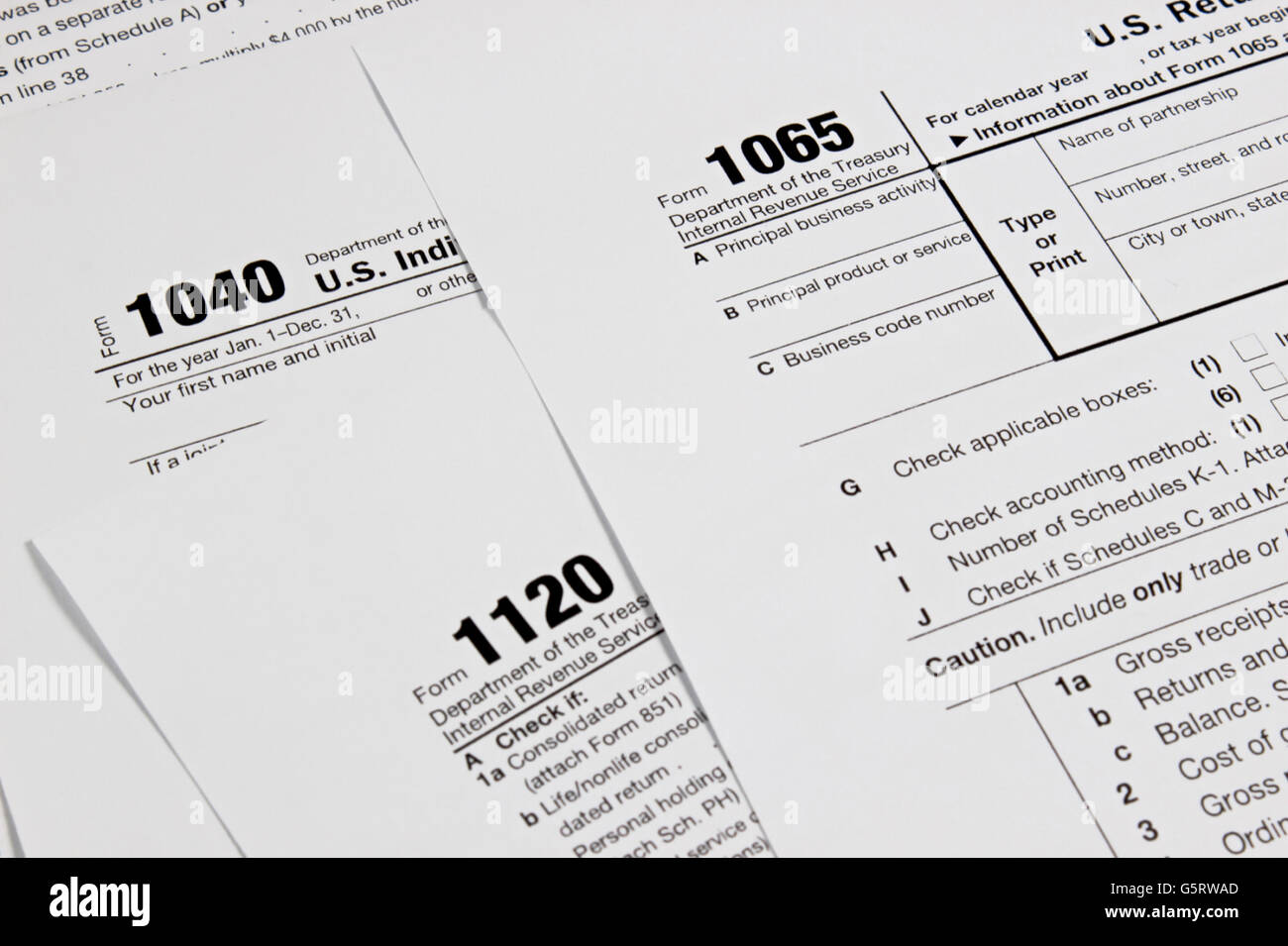 US tax form 1040 on wood table  / taxation concept - Stock Image