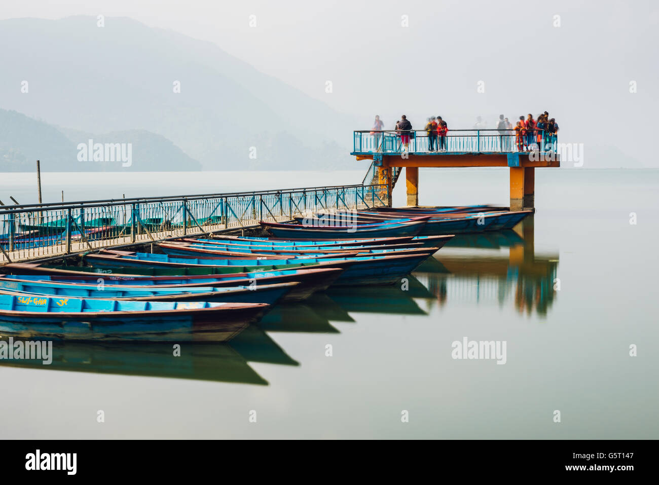 Pier on Fewa Lake in Pokhara, Nepal. Long exposure. - Stock Image
