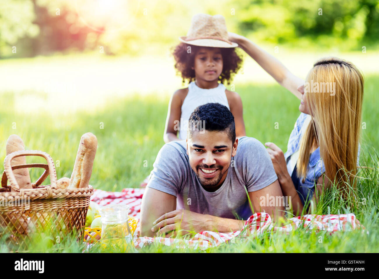 Family enjoying picnicking in nature - Stock Image