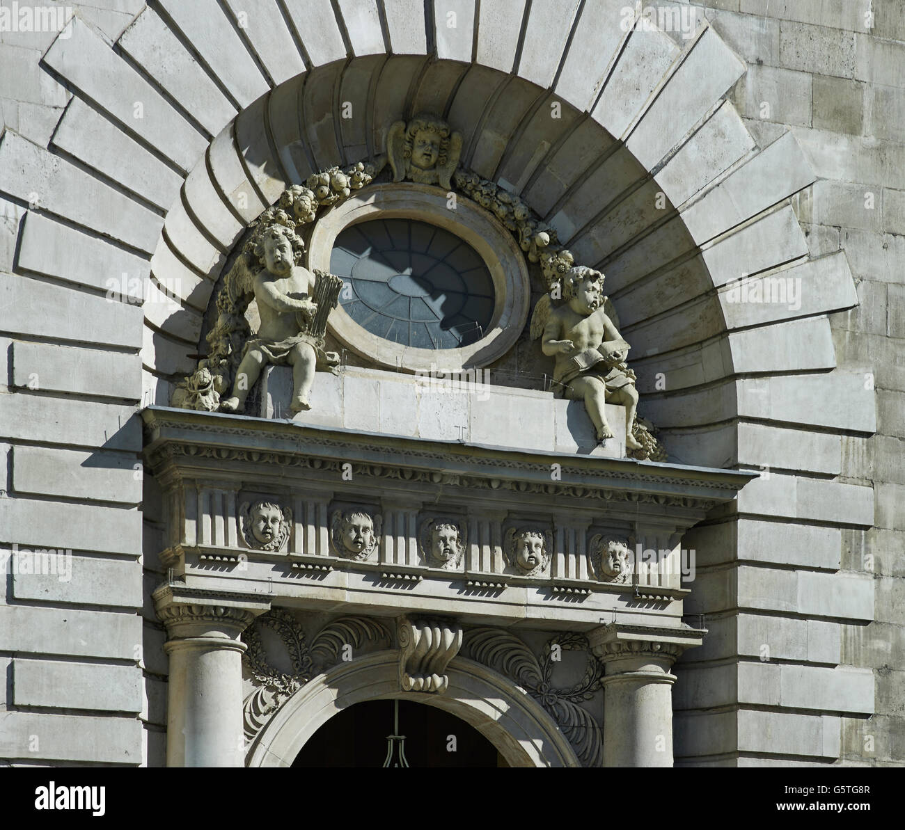 St Mary le Bow, church in the City of London, by Christopher Wren, 1670s arched doorway - Stock Image