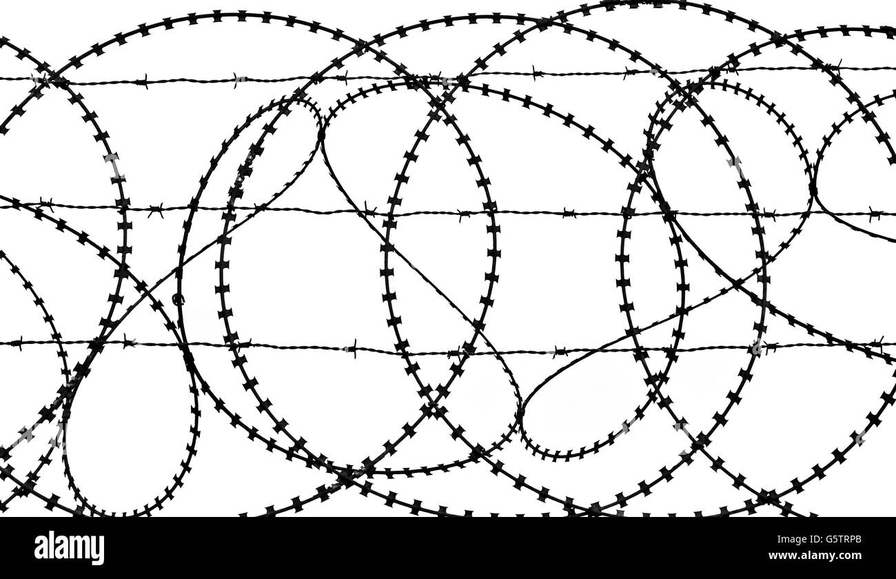 Patterns and shapes in a tangled barbed wire fence (monochrome) - Stock Image