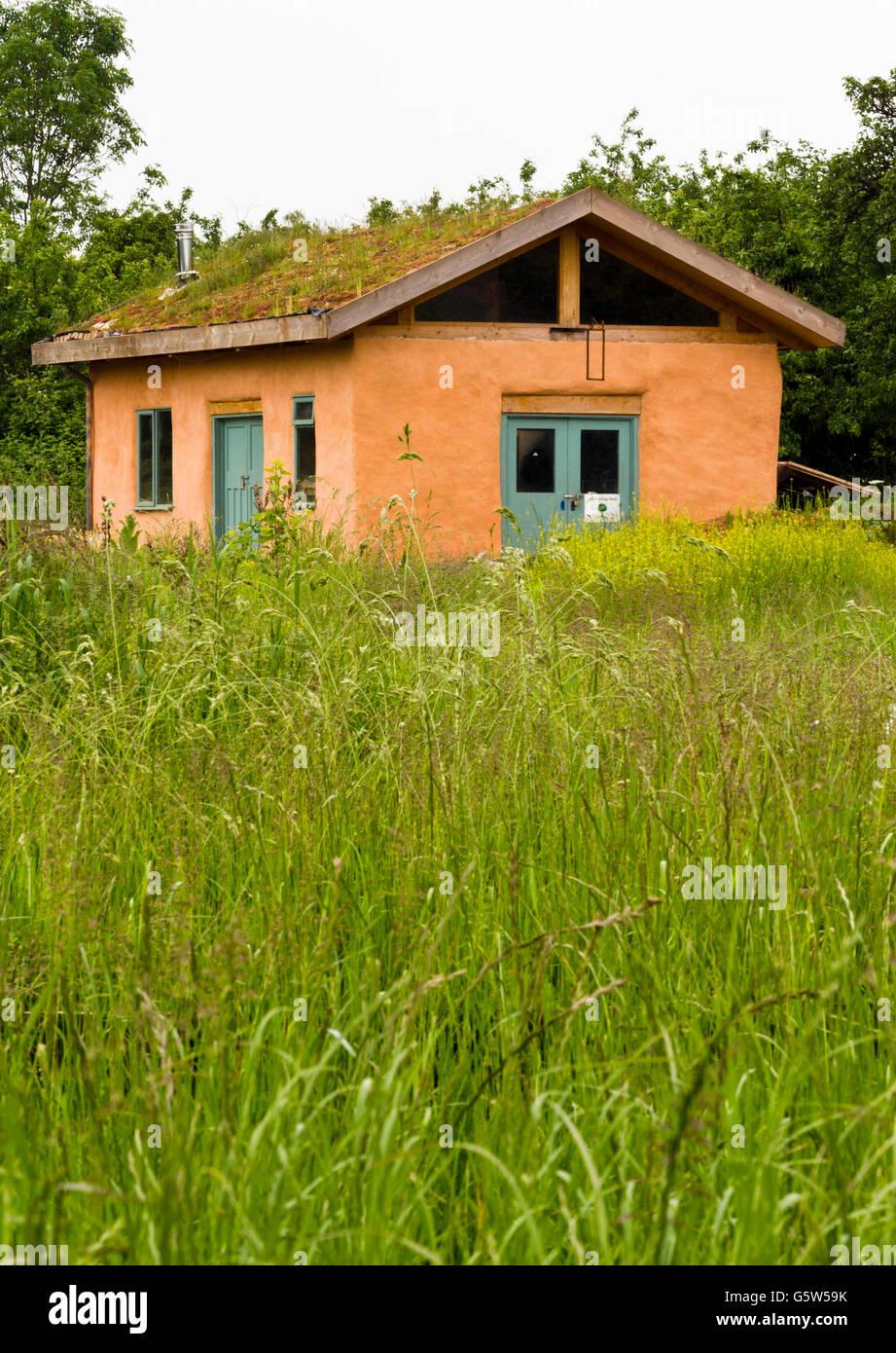 Rustic hut built of natural materials - Stock Image