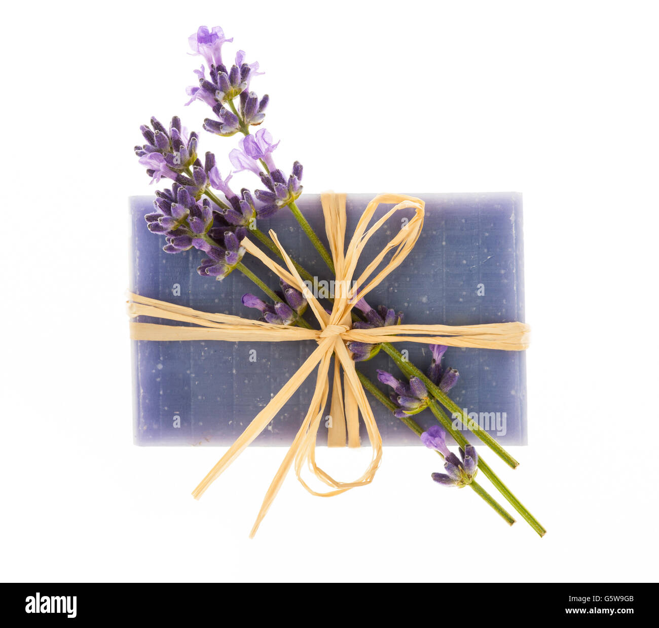 Lavender handmade artisan soap with fresh flowers isolated on white background - Stock Image