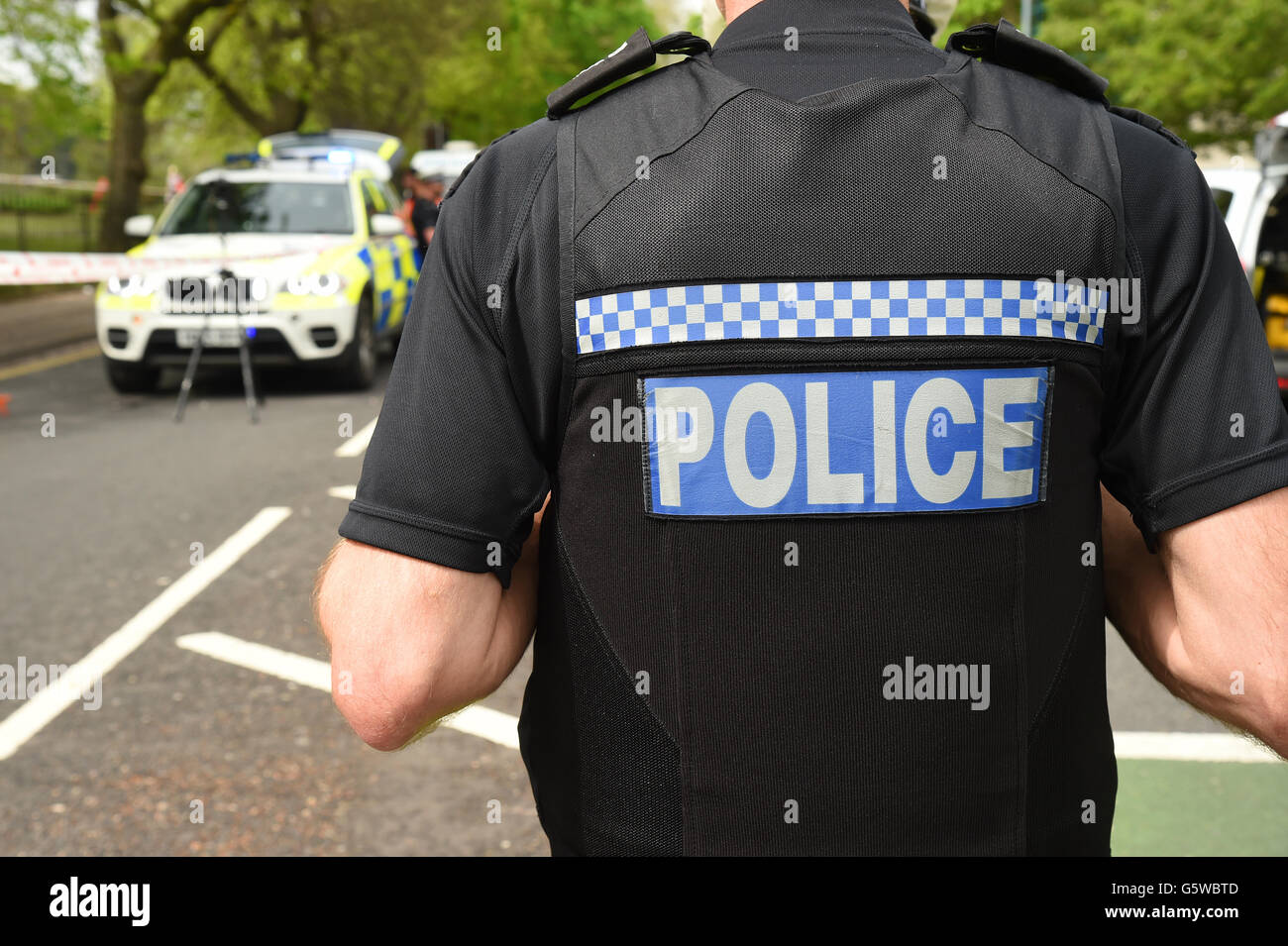 Police officer at the scene of a road traffic accident. - Stock Image