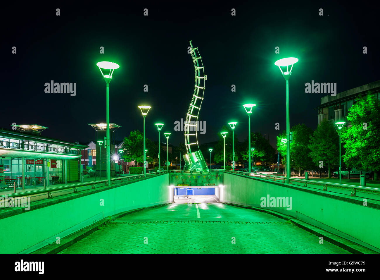 A night time urban scene of the entrance to the Millennium Square car park in the Ciry of Bristol, England. - Stock Image