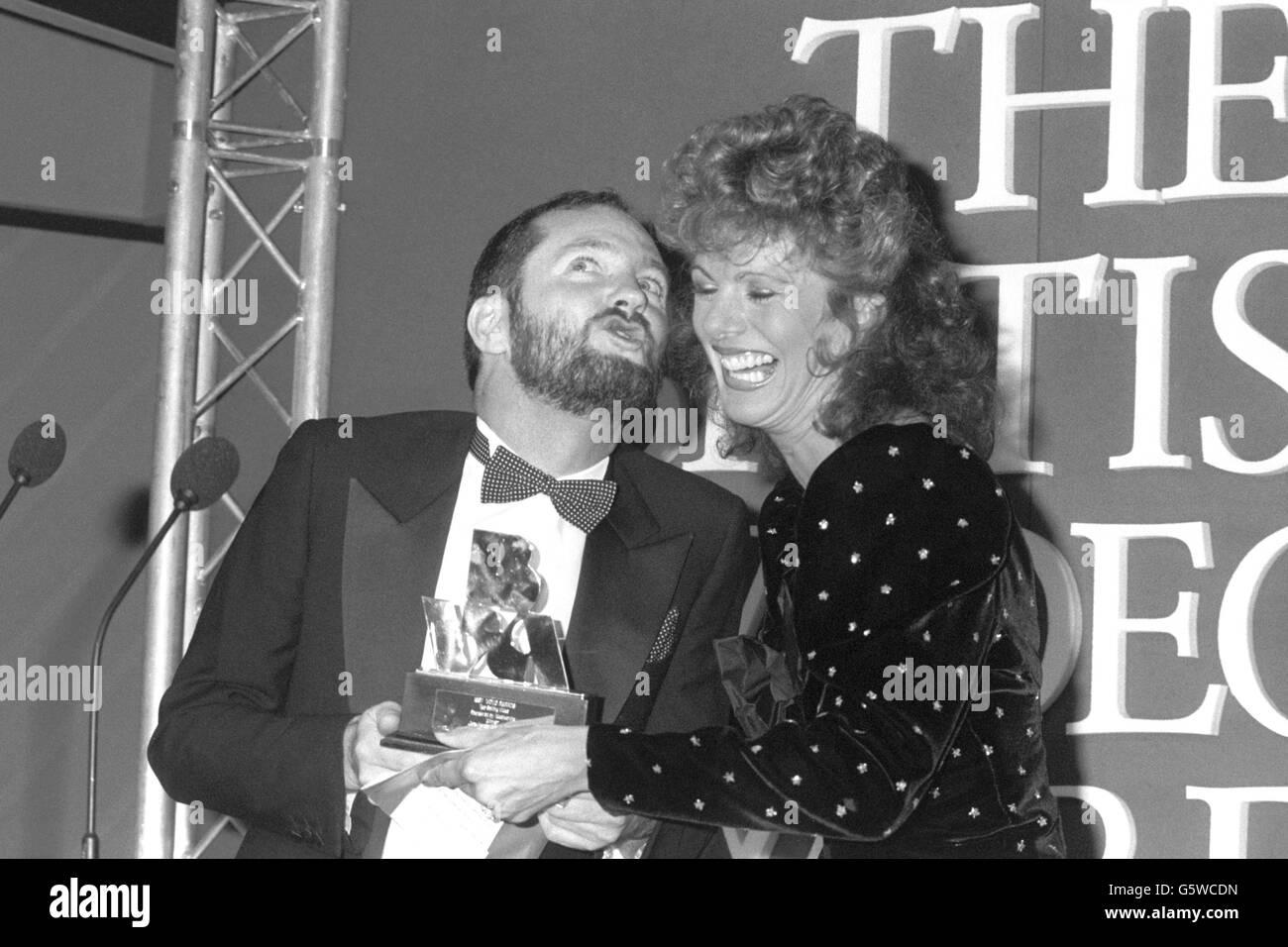 Entertainment - Kenny Everett and Lizzie Webb - British Video Awards Dinner - Grosvenor House Hotel, London - Stock Image