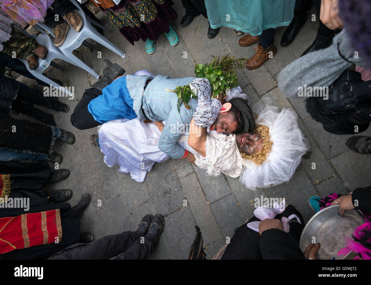 Villagers take part in a symbolic consummation of a wedding at a Pagan, rights of spring, festival held in the village - Stock Image