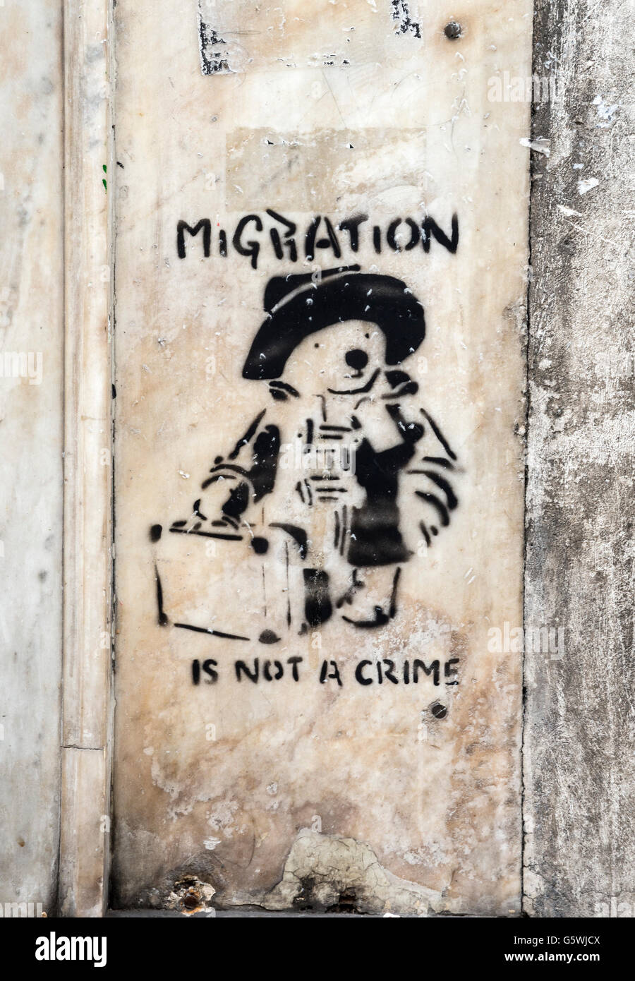 Street art social comment on migration in the Psyrri district of central Athens, Greece - Stock Image