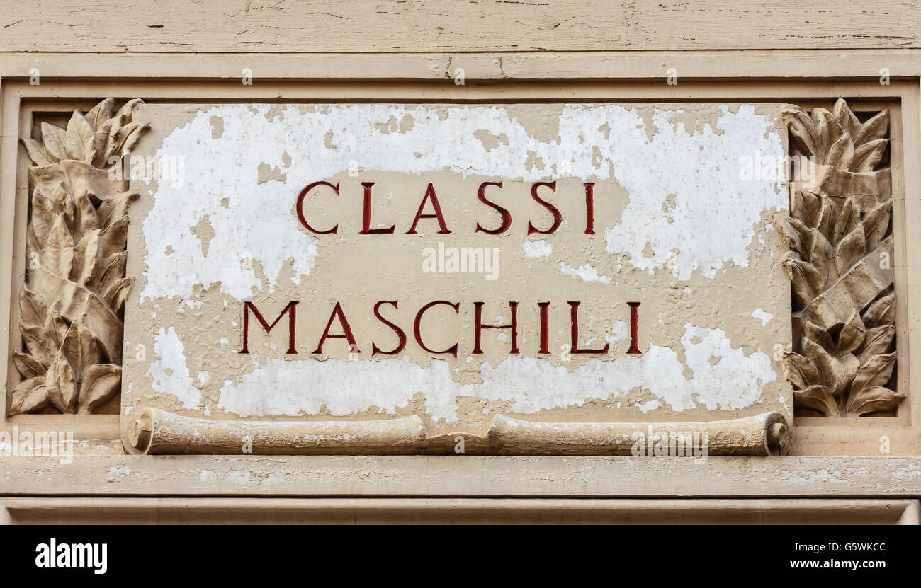 sign made of cement and stone bearing an inscription of the word masculine  classes to indicate the entrance of - Stock Image