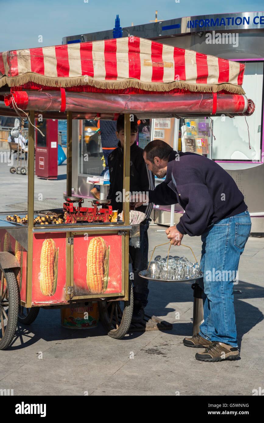 Street vendors on the quay at Eminonu Istanbul, Turkey.. Istanbul, Turkey. - Stock Image