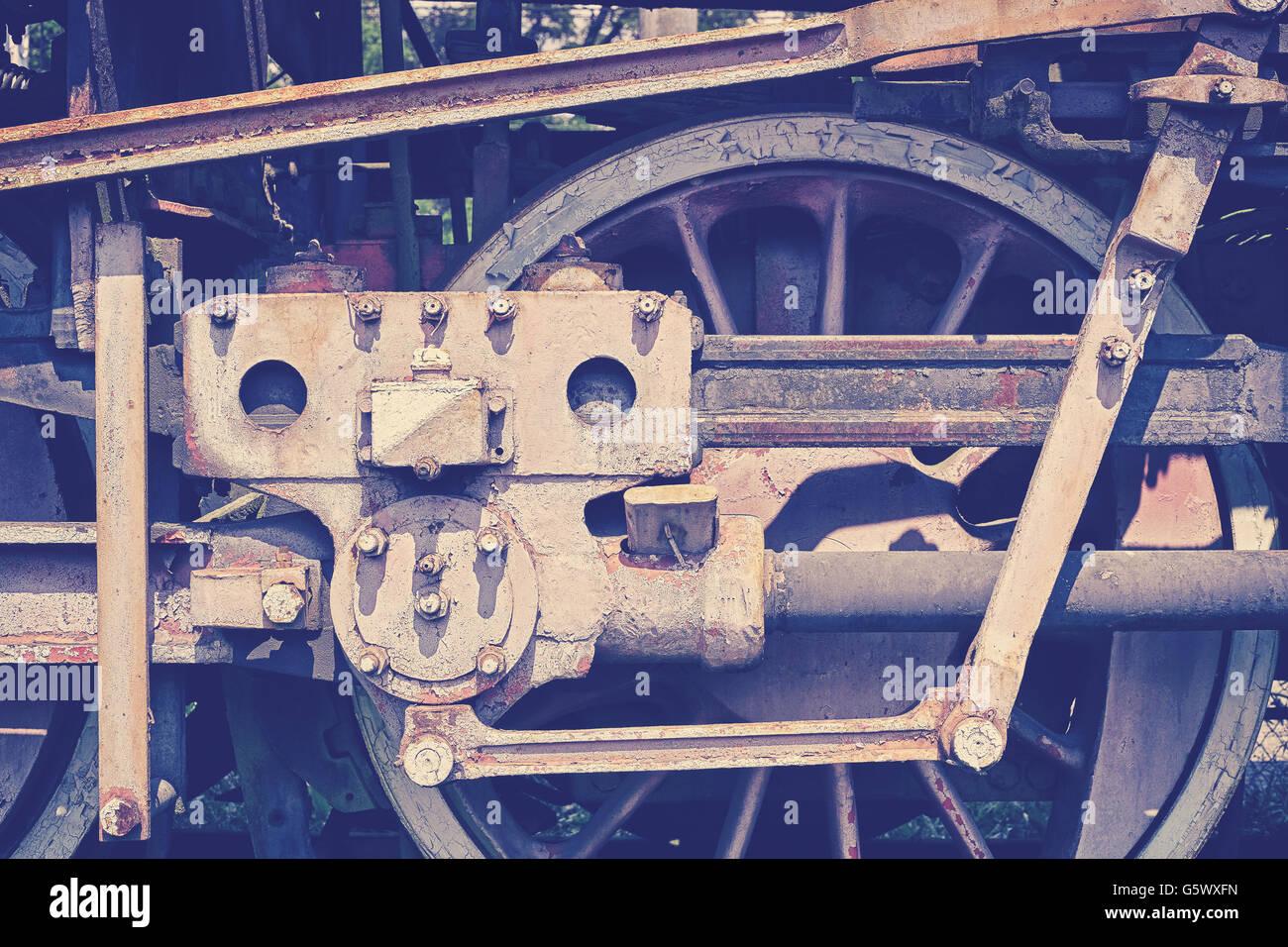 Vintage toned old rusty steam locomotive wheel. - Stock Image