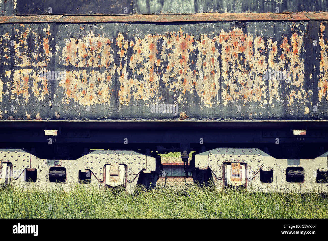 Retro toned old rusty steam locomotive side. - Stock Image