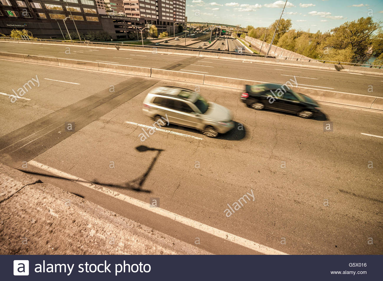 Automobiles on a highway. Stock Photo