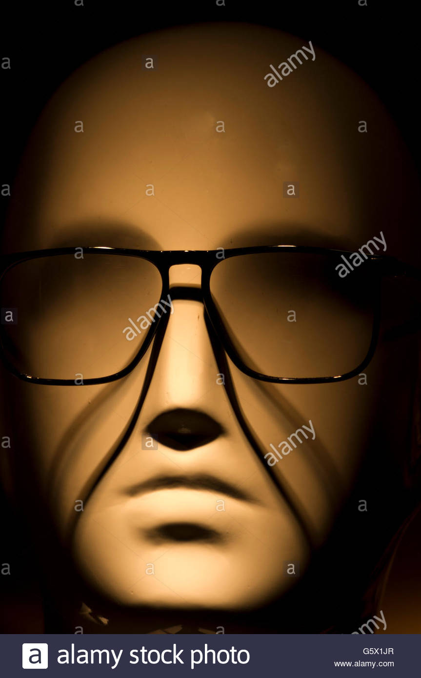 a frightening dummy with glasses - Stock Image