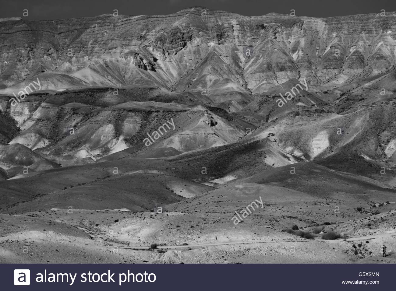 Man taking photos in the Judean Desert - Stock Image