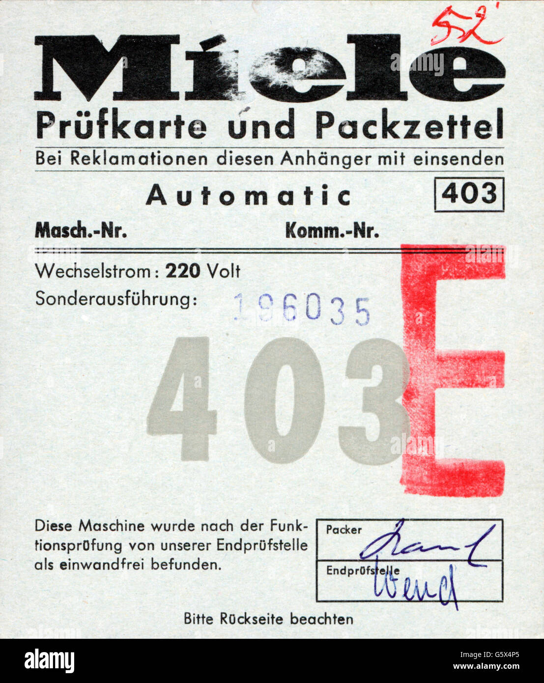 household, household appliances, test card and packing slip for automatic washing machine 403 of the Miele & - Stock Image