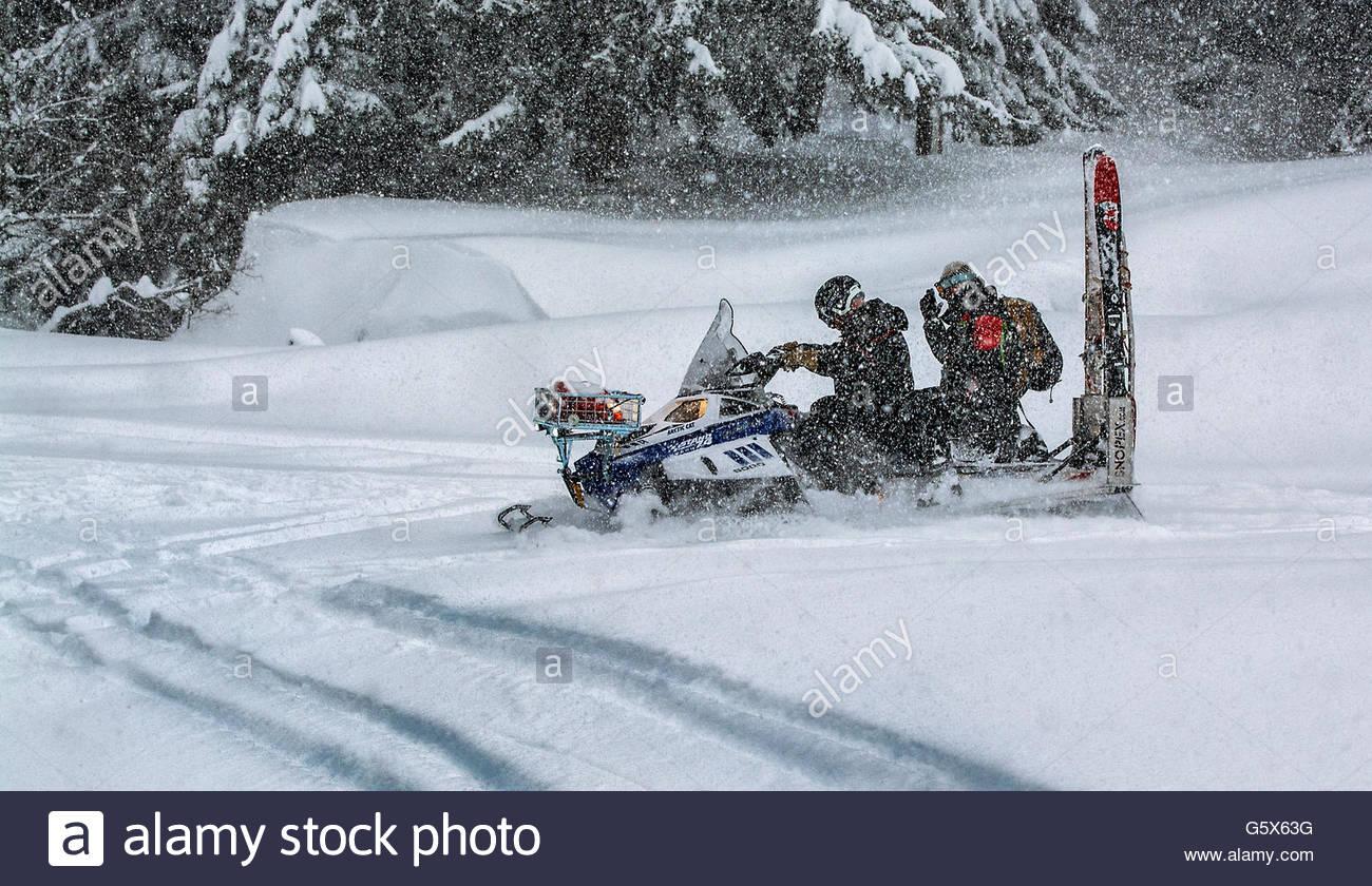 Snowmobile rescue team - Stock Image